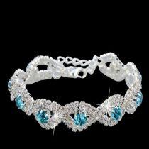 Kristályos, geometrikus karkötő kék kövekkel, ezüst színű