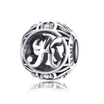Ezüst K betű medál kristályokkal