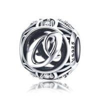 Ezüst O betű medál kristályokkal