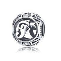 Ezüst F betű medál kristályokkal