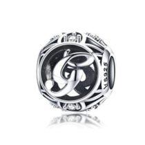Ezüst G betű medál kristályokkal