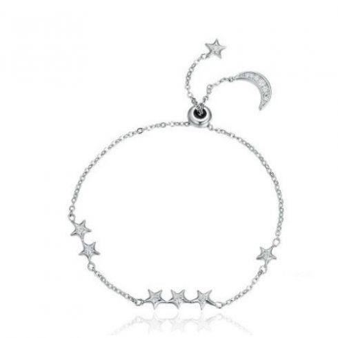 Holddal és csillagokkal díszített ezüst teniszkarkötő