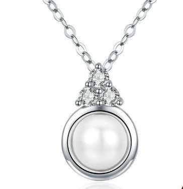 Ezüst nyaklánc kerek medállal és gyönggyel 290dc08675